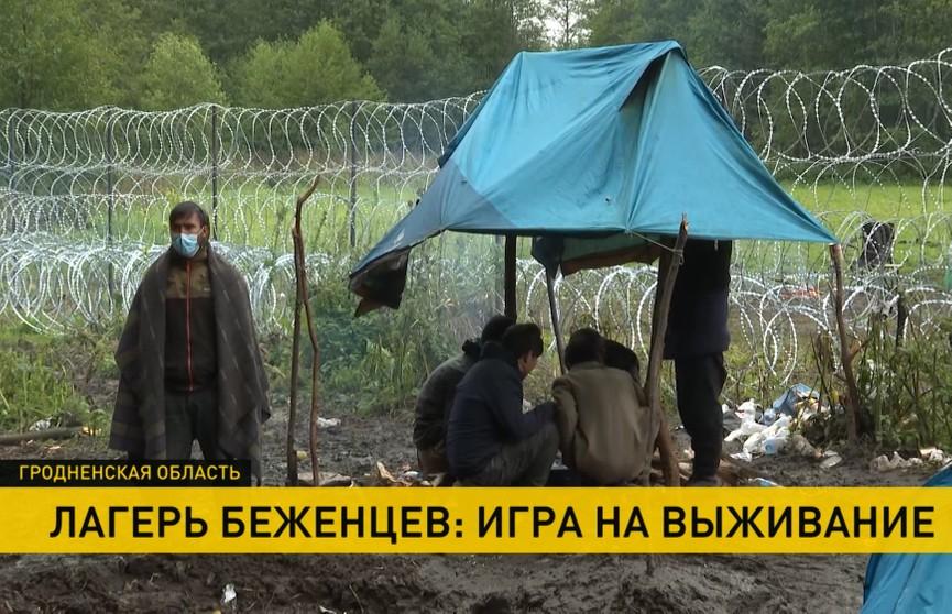 Белорусы передают застрявшим на границе мигрантам теплую одежду и еду