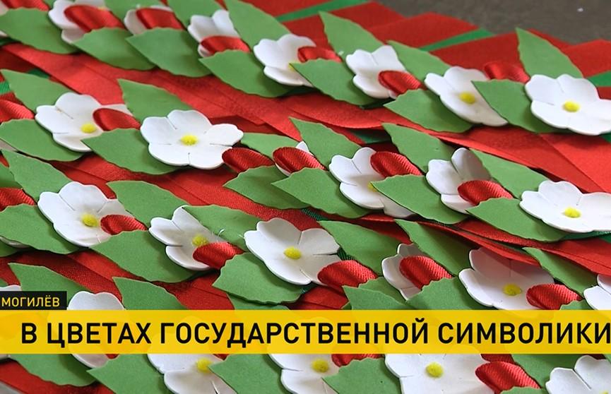Флаг, герб, бутоньерки: где изготавливают национальную символику Беларуси?