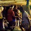 Мигранты с Open Arms провели три недели в море и начали высаживаться на итальянский остров Лампедуза