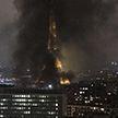 Эйфелева башня окутана чёрным дымом после протестов «жёлтых» жилетов в Париже