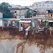 В Гватемале скала обрушилась вместе с жилыми домами