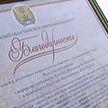 В Могилёвском районе наградили экипаж рекордсменов уборочной кампании